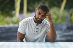 Upset man leaning on table Stock Images