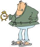 Upset man looking at alarm clock Royalty Free Stock Photos