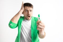 Upset man looking in pregnancy test. Frustrated model. Upset man looking in pregnancy test. Human emotions concept stock images