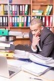 Upset man in office reading documents Stock Photos