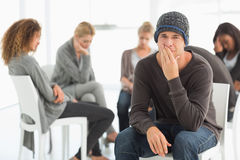 Upset man in rehab group looking at camera Stock Photos