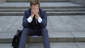 Free Upset Man Sitting On Stairs, Lost Money On Stock Market, Bankruptcy, Dismissal Stock Images - 125574644