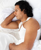 Upset man sleeping separately of his girlfriend Royalty Free Stock Photography
