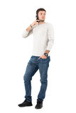 Upset man talking on the phone looking back over the shoulder Royalty Free Stock Photos