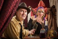 Upset Man with Tarot Cards stock photos