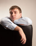 Upset man. Tired office worker in a suit staring pensively Stock Images