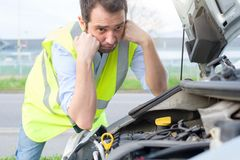Upset man after unexpected car engine breakdown Stock Photos
