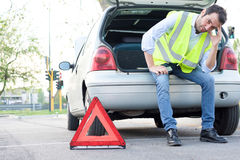 Upset man waiting after unexpected car breakdown royalty free stock photography