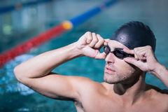 Upset man wearing swimming goggles Stock Photography