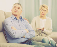Upset mature couple quarreling at home with each other Stock Image
