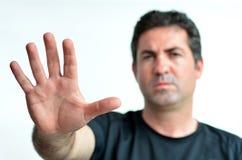 Upset mature man show stop sign with his palm. stock photos