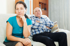 Upset mature woman against elderly man Royalty Free Stock Images