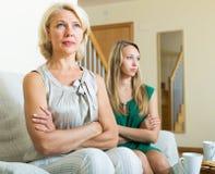 Upset mature woman and daughter having quarrel Royalty Free Stock Photo