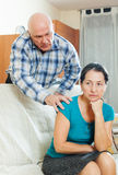 Upset mature woman with husband at home Stock Images