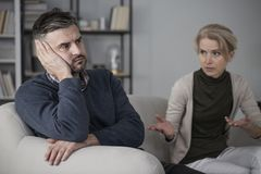 Upset man and complaining wife. Upset men refusing to listen to his constantly complaining wife Royalty Free Stock Image