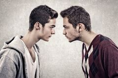 Upset men. Two young angry people standing face to face Royalty Free Stock Photography