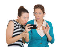 Upset on mobile cell phone Stock Photography