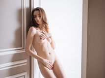 Upset model covering her bare body Stock Photography