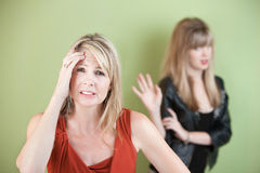 Upset Mom and Daughter. Upset mom with frustrated daughter over green background Stock Photos