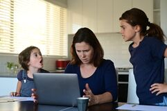 Upset mother forced to work from home as the pandemic coronavirus COVID-19 forces many employees to work from home