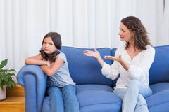 Upset mother looking at her daughter Stock Photo