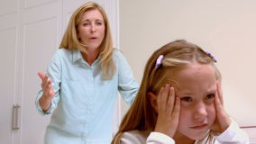 Upset mother scolding her daughter stock footage