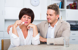 Upset mother turned away from son Stock Photography