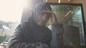 Upset Muslim lady suffering loneliness, ashamed by community for decision made. Stock footage stock video