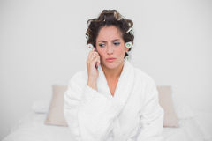 Upset natural brunette phoning Royalty Free Stock Photo