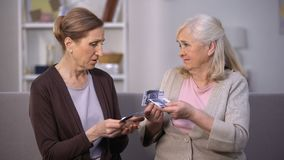 Upset old female friends holding euros banknotes, suffering from poverty stock video footage
