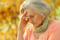 Upset old woman Stock Photography