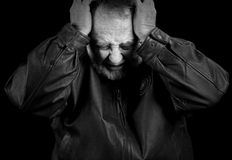 Upset Older Man. Very upset older man distressed or in pain stock photography