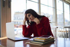 Upset overworked female student feeling exhausted while preparing Stock Photography