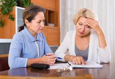 Upset pensioners with documents Royalty Free Stock Images