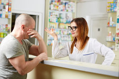 Upset pharmacy customer Stock Photography