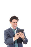 Upset, pissed off and tired man in suit uses tablet for work or Royalty Free Stock Images