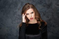 Upset pretty young woman having headache Stock Image