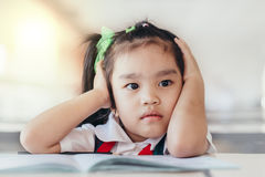 Upset problem child with head in hands Royalty Free Stock Photos
