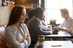Upset rejected girl ghosted by boyfriend in coffeeshop. Upset girl ghosted by boyfriend, waiting for him alone in coffeeshop, frustrated female rejected by royalty free stock image