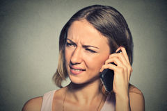 Upset sad annoyed unhappy woman talking on cell phone Royalty Free Stock Photo
