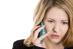 Upset, sad, depressed and worried blonde woman talking on the phone Royalty Free Stock Image