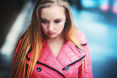 The upset sad girl  on the street Royalty Free Stock Photos