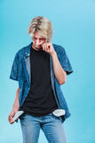 Upset sad man showing empty pockets. Financial difficulties, bad economy, no money concept. Young man male student showing empty pockets, sad unhappy face Stock Image
