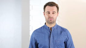 Upset sad middle aged man portrait. 4k  high quality stock video footage