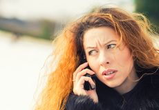 Upset sad, skeptical, unhappy, serious woman talking on phone Royalty Free Stock Photography