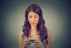 Upset sad skeptical unhappy serious woman talking texting on phone Stock Photos
