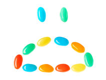 Upset sad smiley made of multicolored candies Royalty Free Stock Images
