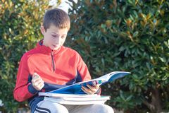 Upset sad teenager with textbooks and notebooks royalty free stock photo