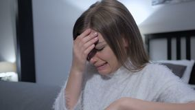 Upset Sad Woman Crying while Sitting Indoor. 4k , high quality stock video