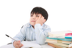 Upset schoolboy doing homework Stock Photo